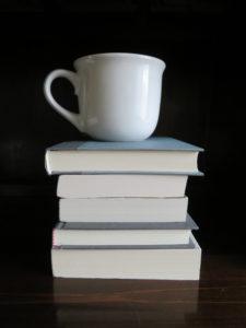 Giant Coffee Mug on Books